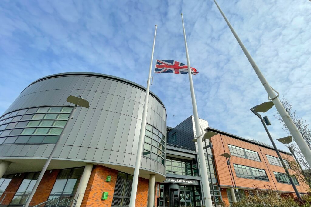 Flag at half-mast outside office building